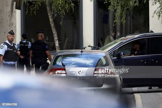 Key witness Murielle Bolle arrives by car escorted by a French gendarm at the Court of Appeal in Dijon on July 28 2017 ahead of a confrontation with...
