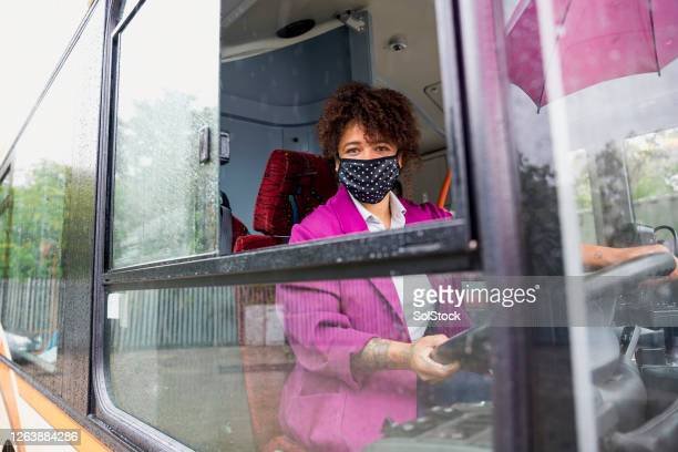 key worker wearing a protective mask - public transport stock pictures, royalty-free photos & images