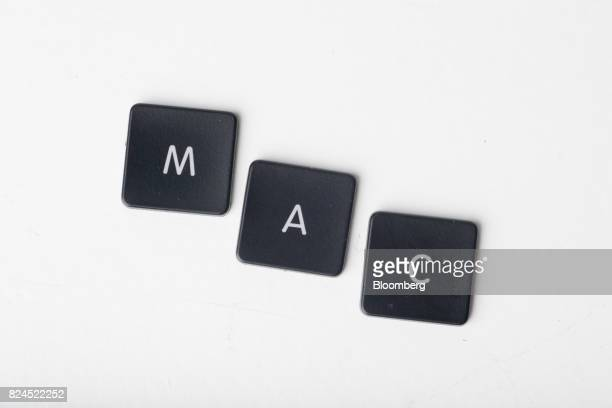 Keyboard letters from an Apple Inc MacBook Pro laptop computer spell out 'MAC' in an arranged photograph in Bangkok Thailand on Saturday July 29 2017...