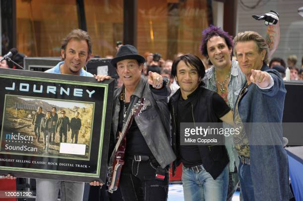 keyboard player Jonathan Cain guitar player Neal Schon singer Arnel Pineda drummer Deen Castronovo and bass player Ross Valory of the band Journey...