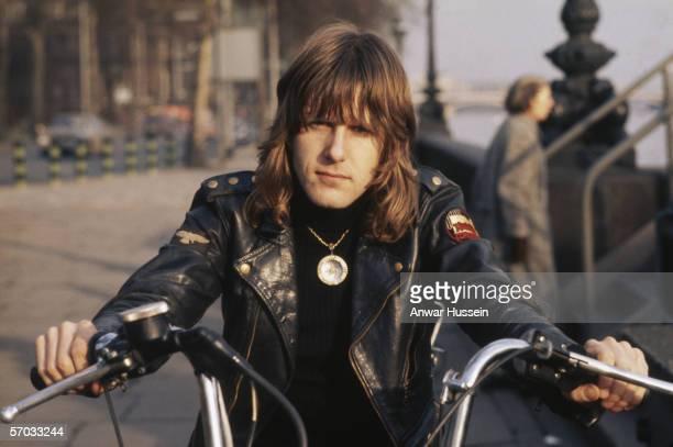 Keyboard player Keith Emerson, of prog rock supergroup Emerson, Lake & Palmer, on a motorbike, London, circa 1975.
