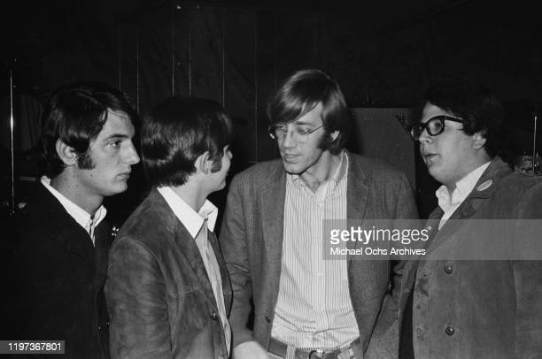 Keyboard player Ray Manzarek of American rock band The Doors talks with three young men at the Ondine Club in New York City where the band are in...