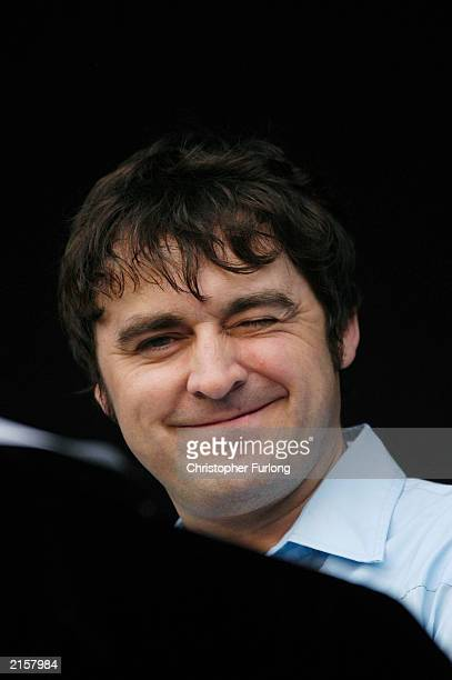 Keyboard player Tony Rogers of music group The Charlatans performs during The T In The Park Festival on July 13 2003 at Balado near Kinross in...