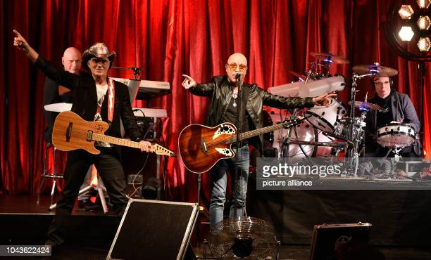 Keyboarder Mnafred 'Manne' Hennig guitarist Fritz Puppel singer Toni Krahl and drummer Klaus Selmke of the band 'City' perform at the Maschinenhaus...