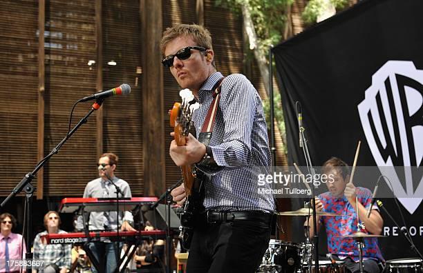 Keyboardist Darren Sell bassist Steven Jeffery and druimmer Michael Jeffery of Atlas Genius perform live at Warner Bros Records Boutique Store on...