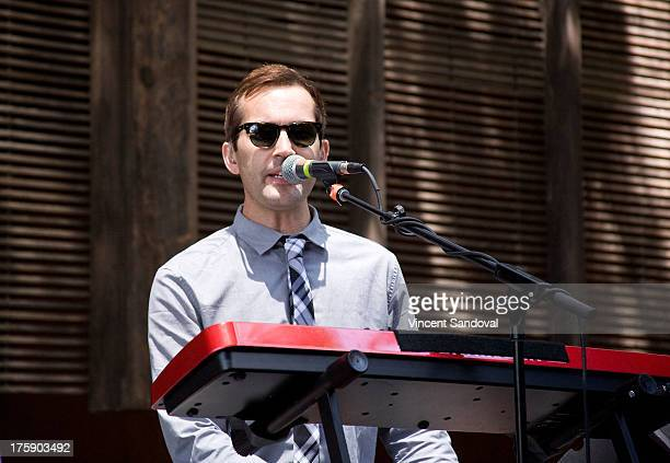 Keyboardist Darren Sell of Atlas Genius performs at the WBR Summer Sessions at Warner Bros Records boutique store on August 9 2013 in Burbank...