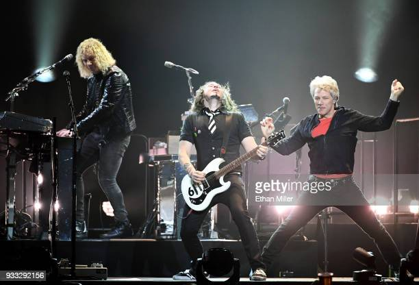 Keyboardist David Bryan guitarist Phil X and frontman Jon Bon Jovi of Bon Jovi perform during a stop of the band's This House is Not for Sale Tour at...