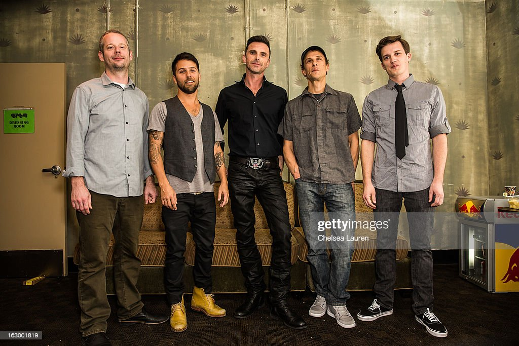 Keyboardist David Phipps, drummer Zach Velmer, bassist David Murphy, guitarist Hunter Brown and percussionist Jeffree Lerner of Sound Tribe Sector 9 pose backstage at Hollywood Palladium on March 2, 2013 in Hollywood, California.