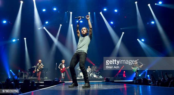 Keyboardist Jonathan Cain bassist Ross Valory singer Arnel Pineda drummer Steve Smith and founder and guitarist Neal Schon of the band Journey are...
