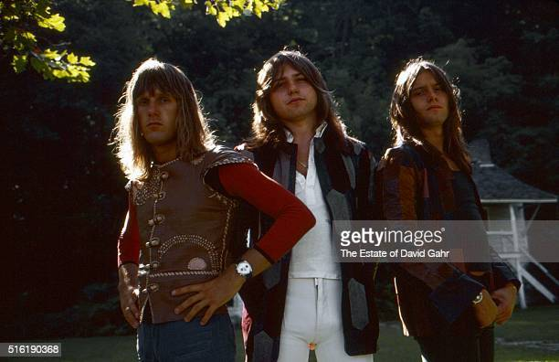 Keyboardist Keith Emerson, bassist Greg Lake, and drummer Carl Palmer of progressive rock group Emerson, Lake, and Palmer pose for a portrait in...