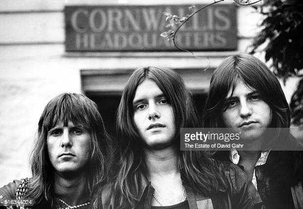Keyboardist Keith Emerson, drummer Carl Palmer, and bassist Greg Lake of progressive rock group Emerson, Lake, and Palmer pose for a portrait in...