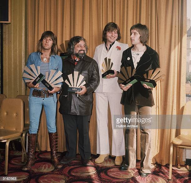 Keyboardist Keith Emerson, lead singer and bassist Greg Lake and drummer Carl Palmer of the British group Emerson Lake And Palmer receive their...