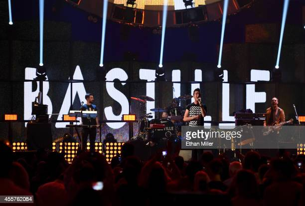 Keyboardist Kyle Simmons drummer Chris Woody Wood frontman Dan Smith and bassist Will Farquarson of Bastille perform onstage during the 2014...
