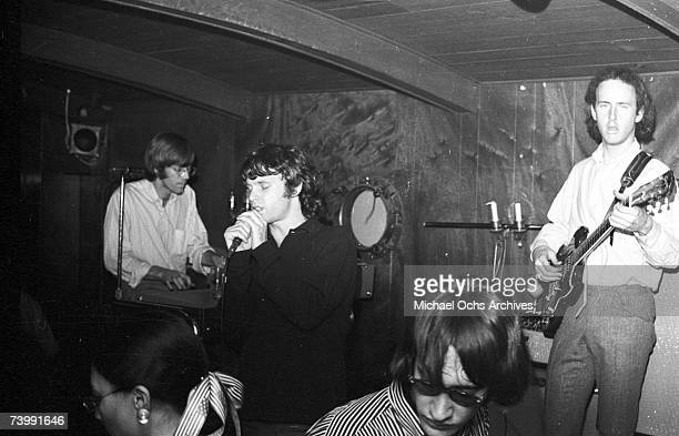 Keyboardist Ray Manzarek singer Jim Morrison and guitarist Robby Krieger of the rock and roll band The Doors perform onstage at Ondine nightclub in...