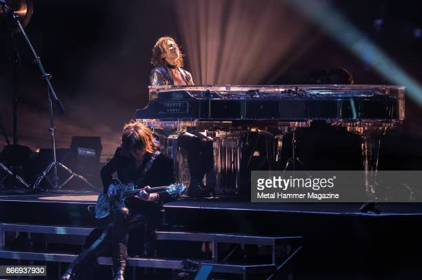 Keyboardist Yoshiki Hayashi and guitarist Yune Sugihara of Japanese glam metal group X Japan performing live on stage at the SSE Wembley Arena in...