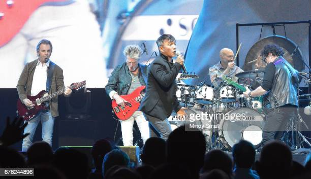 Keyboardist/guitarist Jonathan Cain bassist Ross Valory vocalist Arnel Pineda drummer Steve Smith and guitarist Neal Schon of Journey perform during...