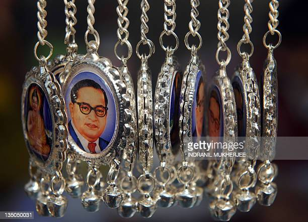 Keychains with images of Bhimrao Ambedkar and Lord Gautam Buddha are displayed for sale on Ambedkar's 55th death anniversary near the historic...
