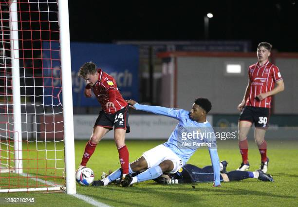 Keyendrah Simmonds of Man City scores his sides first goal during the EFL Trophy match between Lincoln City and Manchester City U21 at Sincil Bank...