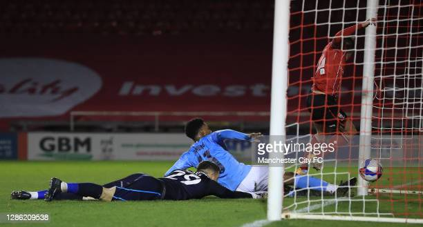 Keyendrah Simmonds of Manchester City U21 scores a goal during the EFL Trophy match between Lincoln City and Manchester City U21 at Sincil Bank...