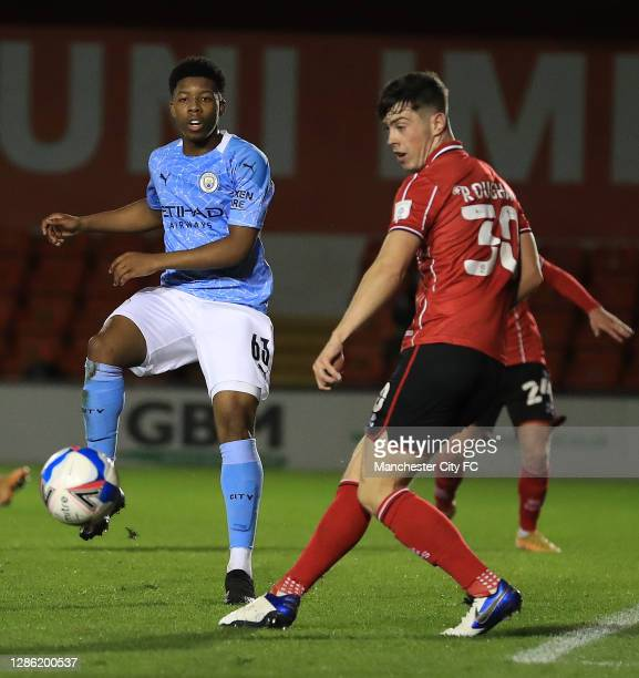 Keyendrah Simmonds of Manchester City U21 wins the ball from Sean Roughan of Lincoln City during the EFL Trophy match between Lincoln City and...