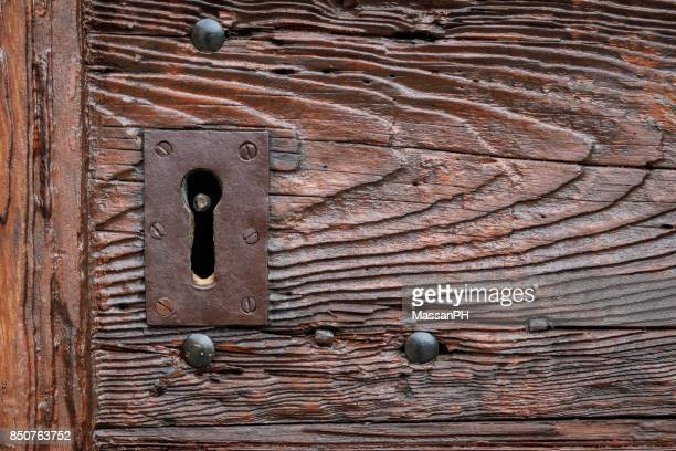 Keyhole of the wooden doorway of a medieval church