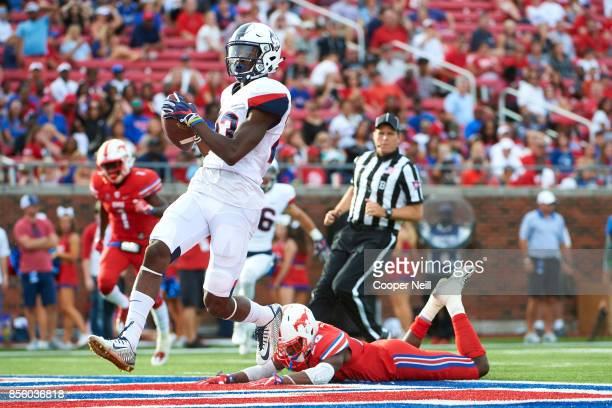 Keyion Dixon of the Connecticut Huskies breaks free for a 59 yard touchdown reception against the SMU Mustangs during the second half at Gerald J...