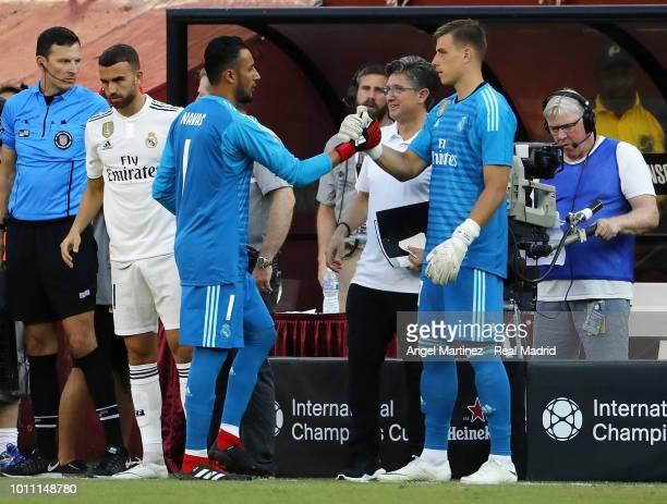 Keylor Navas and Andriy Lunin of Real Madrid shake hands during the International Champions Cup 2018 match between Real Madrid and Juventus at...