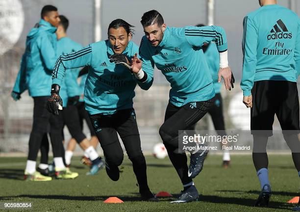 Keylor Navas and Kiko Casilla of Real Madrid exercise during a training session at Valdebebas training ground on January 17 2018 in Madrid Spain