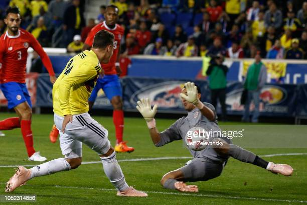 Keylor Navas of Costa Rica deflects a shot by Santiago Arias of Colombia during their match at Red Bull Arena on October 16 2018 in Harrison New...
