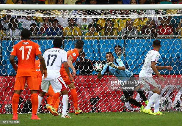 Keylor Navas of Costa Rica makes a save during the 2014 FIFA World Cup Brazil Quarter Final match between the Netherlands and Costa Rica at Arena...