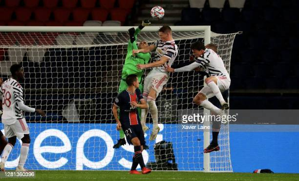 Keylor Navas of Paris SaintGermain kick the ball over Scott Mc Tominay of Manchester United during the UEFA Champions League Group H stage match...