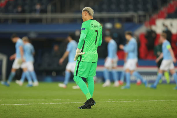 Keylor Navas of Paris Saint-Germain looks dejected after conceding their side's first goal scored by Kevin De Bruyne of Manchester City during the...