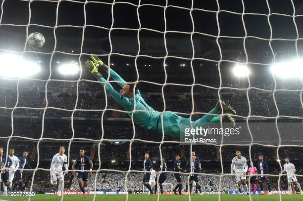 Keylor Navas of Paris Saint-Germain reaches for the ball as Gareth Bale of Real Madrid hits the post from a freekick during the UEFA Champions League...
