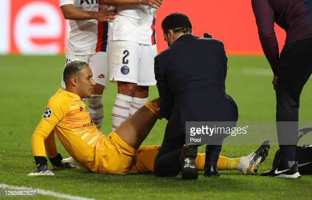 Keylor Navas of Paris Saint-Germain receives medical treatment during the UEFA Champions League Quarter Final match between Atalanta and Paris...