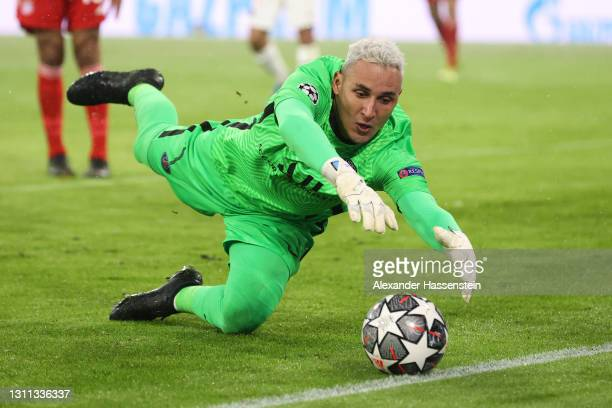 Keylor Navas of Paris Saint-Germain stretches to keep the ball in play during the UEFA Champions League Quarter Final match between FC Bayern Munich...