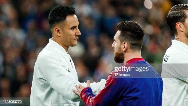 Keylor Navas of Real Madrid and Lionel Messi of FC Barcelona gesture prior to the Copa del Semi Final match second leg between Real Madrid and...