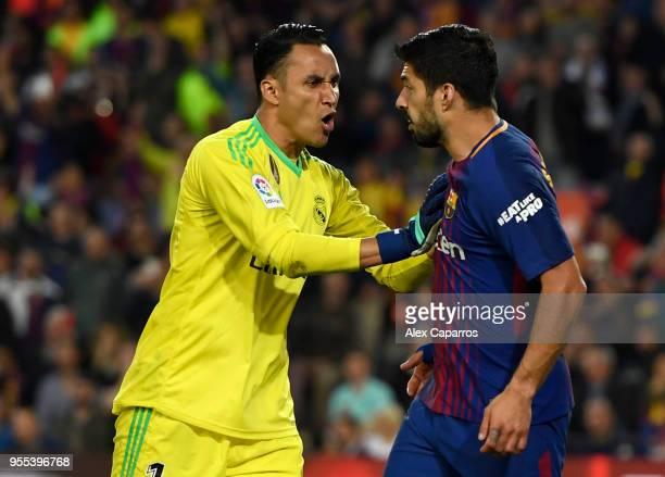 Keylor Navas of Real Madrid and Luis Suarez of Barcelona clash during the La Liga match between Barcelona and Real Madrid at Camp Nou on May 6 2018...