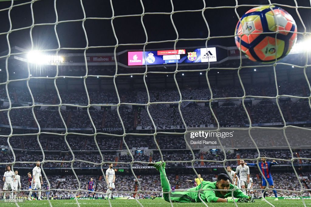 Keylor Navas of Real Madrid CF fails to stop Lionel Messi of FC Barcelona (not pictured) from scoring his team's third goal during the La Liga match between Real Madrid CF and FC Barcelona at the Santiago Bernabeu stadium on April 23, 2017 in Madrid, Spain.
