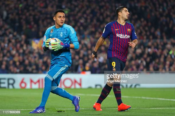 Keylor Navas of Real Madrid CF grabs the ball next to Luis Suarez of FC Barcelona during the Copa del Semi Final first leg match between Barcelona...