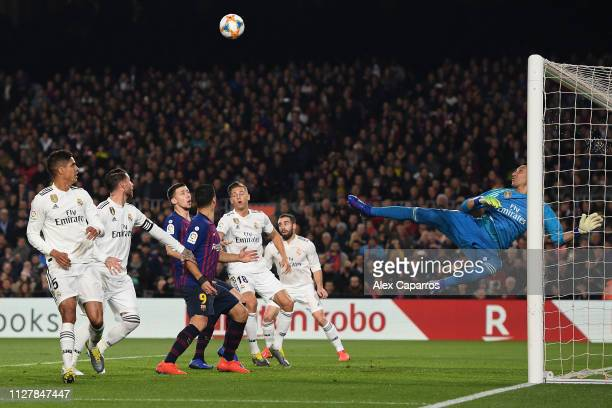 Keylor Navas of Real Madrid CF makes a save during the Copa del Semi Final first leg match between Barcelona and Real Madrid at Nou Camp on February...