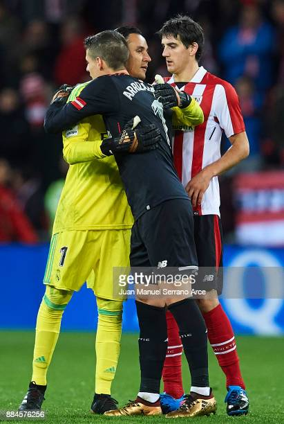 Keylor Navas of Real Madrid CF shake hands wth Kepa Arrizabalaga of Athletic Club during the La Liga match between Athletic Club and Real Madrid at...