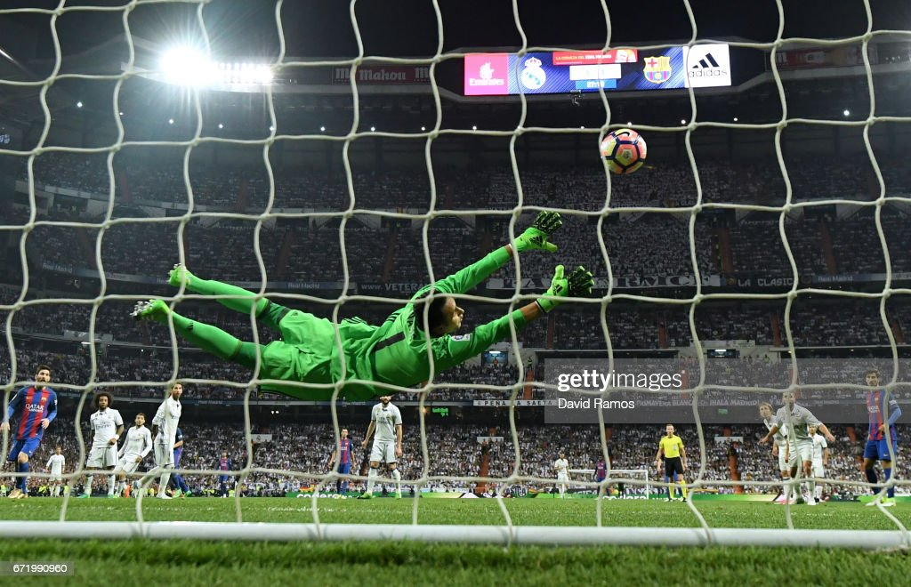 Keylor Navas of Real Madrid fails to stop Ivan Rakitic of Barcelona (not pictured) from scoring their second goal during the La Liga match between Real Madrid CF and FC Barcelona at Estadio Bernabeu on April 23, 2017 in Madrid, Spain.