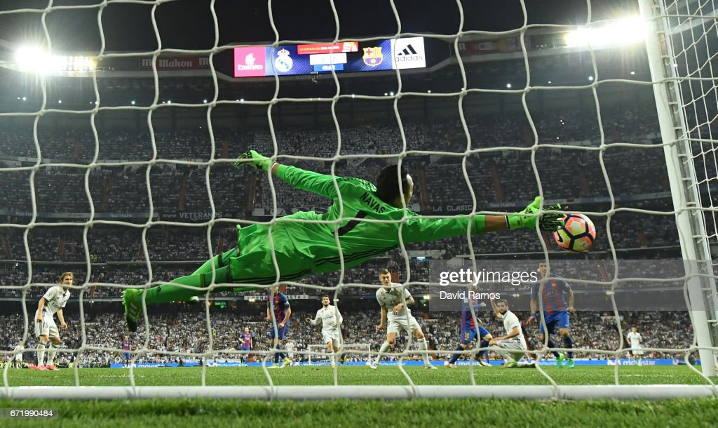 Keylor Navas of Real Madrid fails to stop Lionel Messi of Barcelona (10) from scoring their third goal during the La Liga match between Real Madrid CF and FC Barcelona at Estadio Bernabeu on April 23, 2017 in Madrid, Spain.