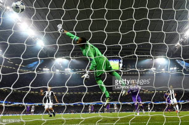 Keylor Navas of Real Madrid fails to stop Mario Mandzukic of Juventus shot for Juventus first goal during the UEFA Champions League Final between...