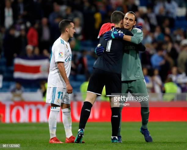 Keylor Navas of Real Madrid hugs Kepa of Athletic Club after the La Liga match between Real Madrid and Athletic Club at Estadio Santiago Bernabeu on...