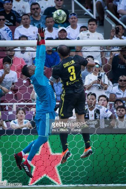 Keylor Navas of Real Madrid jumps to save the shot on goal by Giorgio Chiellini of Juventus during the the International Champions Cup soccer match...