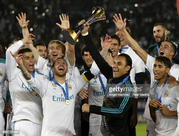 Keylor Navas of Real Madrid lifts the trophy with his team mates at the end of the FIFA Club World Cup UAE 2017 Final match between Real Madrid CF...