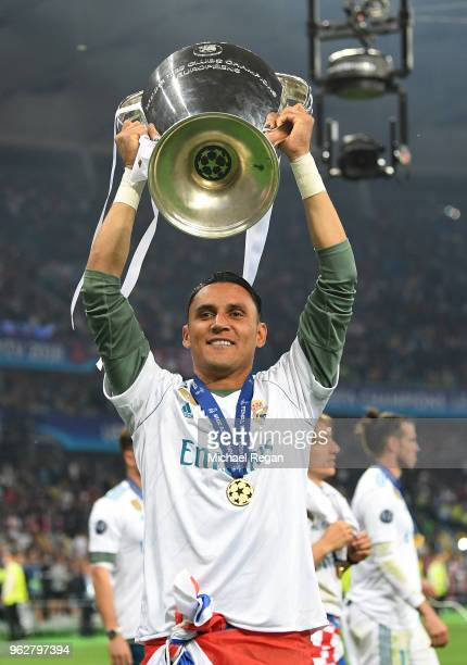Keylor Navas of Real Madrid lifts The UEFA Champions League trophy following their sides victory in the UEFA Champions League Final between Real...