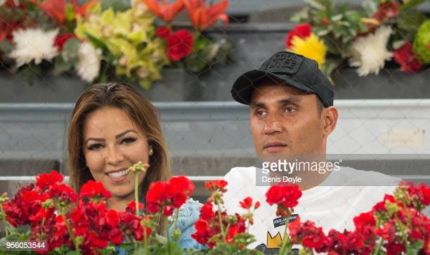 Keylor Navas of Real Madrid looks on with his wife Andrea Salas while watching Fernando Verdasco of Spain play Paolo Lorenzi of Italy in the 1st...