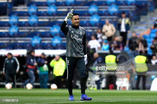 Keylor Navas of Real Madrid waves to fans during the warm up ahead of the La Liga match between Real Madrid CF and SD Huesca at Estadio Santiago...